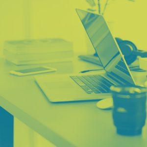 duotone laptop open on desk