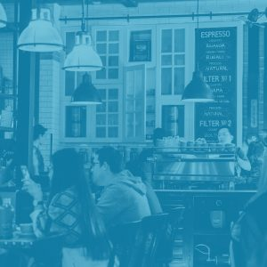 duotone image of a coffee shop filled with people